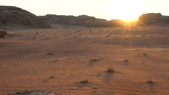 dramatic sunrise over the wadi rum desert wilderness very early in the morning, jordan - ground culinary stock videos & royalty-free footage