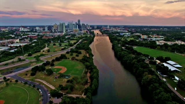 Dramatic Sunset Brings Colors to Texas Hill Country Downtown Austin Texas City Skyline Over Colorado River