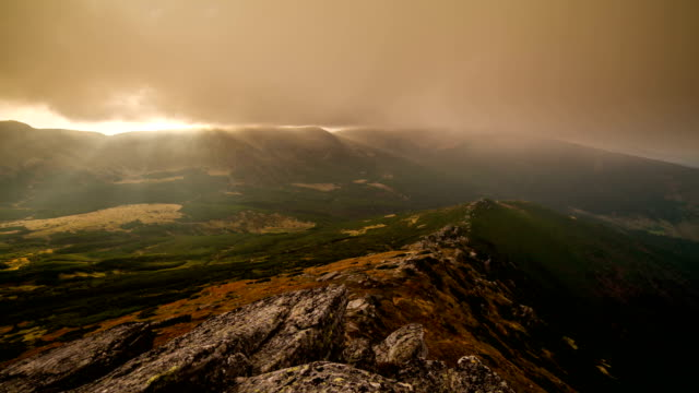 dramatic sunset in the mountains. sunrays and mist. timelapse - ukraine stock videos and b-roll footage