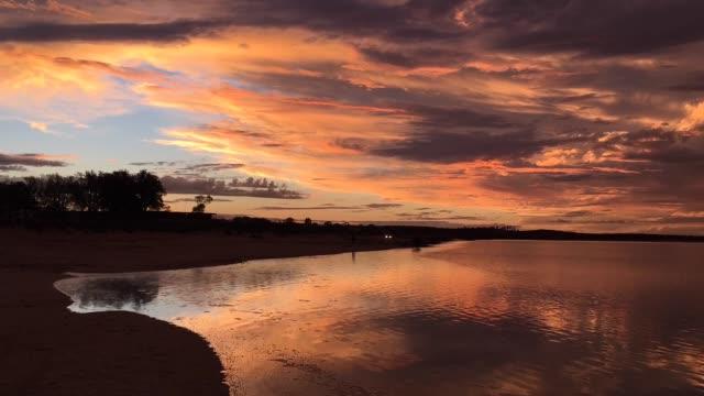dramatic sunset over inlet  in port augusta south australia time lapse - south australia bildbanksvideor och videomaterial från bakom kulisserna