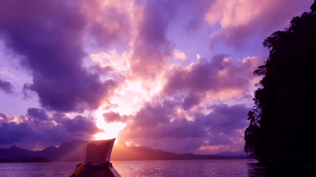 dramatic sunset over the mountains and the sea - krabi province stock videos & royalty-free footage