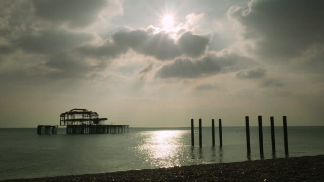 Dramatic time lapse shot of clouds drifting over Brighton's derelict West Pier.