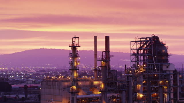 dramatic uav flight over oil refineries at sunset - port of los angeles stock videos & royalty-free footage