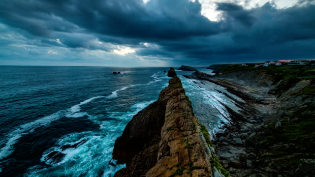 dramatic view of playa de la arnia, cantabria, spain. timelapse - meerlandschaft stock-videos und b-roll-filmmaterial