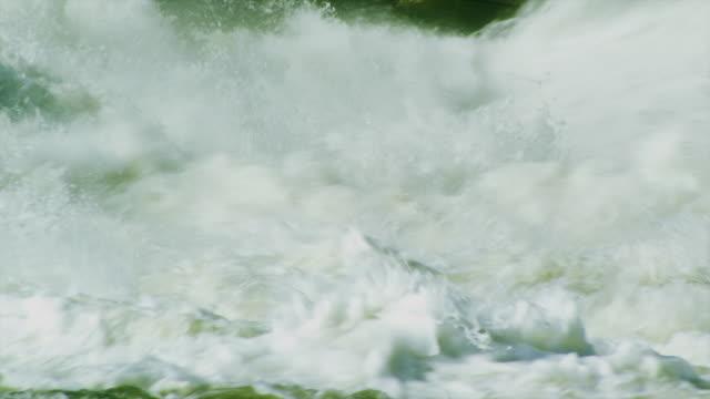 Dramatic water churning behind dam