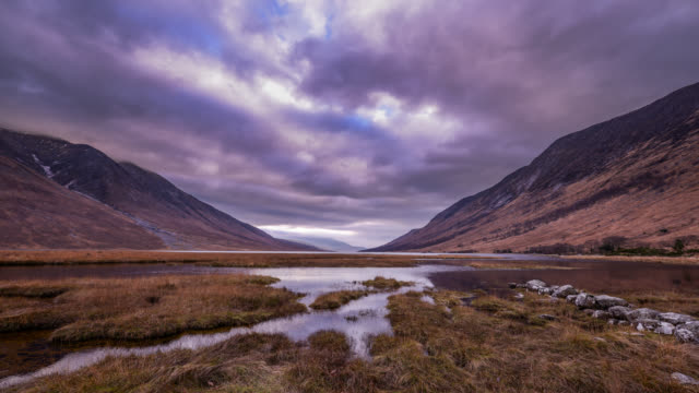 dramatic weather over loch near glencoe scotland - rolling landscape stock videos & royalty-free footage