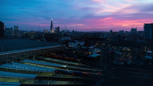 a dramatic winter sunrise time lapse of waterloo station (london, uk) featuring trains arriving and departing with views of the shard in the background - filiz stock videos & royalty-free footage