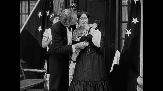 dramatization - 1860s a southern man comforts a woman who cries - ehefrau stock-videos und b-roll-filmmaterial