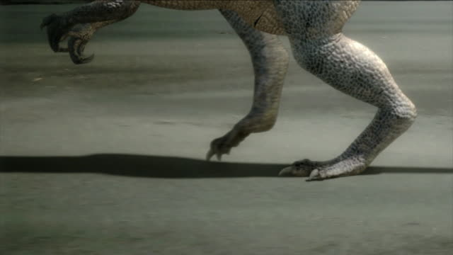 a dramatization shows a bipedal dinosaur hunting. - extinct stock videos & royalty-free footage