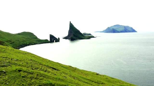 dranganir rock at the faroe islands - rock face stock videos & royalty-free footage
