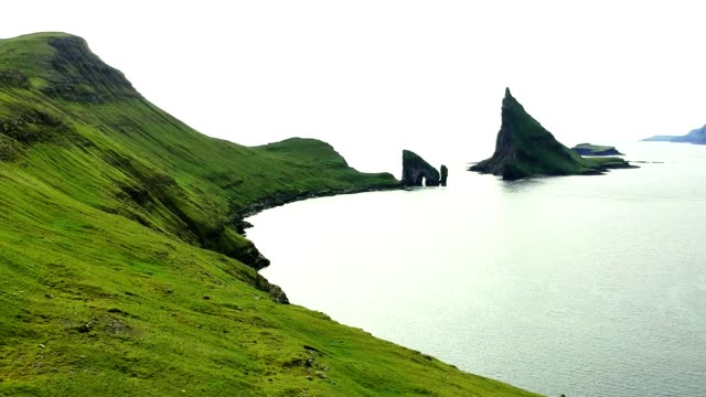 dranganir rock at the faroe islands - rock face stock videos and b-roll footage