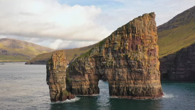 drangarnir rocks faroe islands vagar island drone flight 4k - rock face stock videos & royalty-free footage