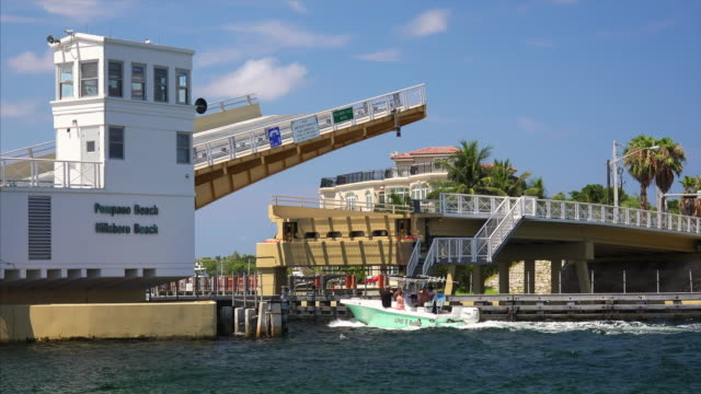 drawbridge opens to let boats pass on intracoastal waterway in pompano beach, florida - timelapse - drawbridge stock videos and b-roll footage