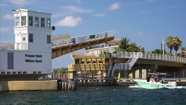 drawbridge opens to let boats pass on intracoastal waterway in pompano beach, florida - drawbridge stock videos and b-roll footage