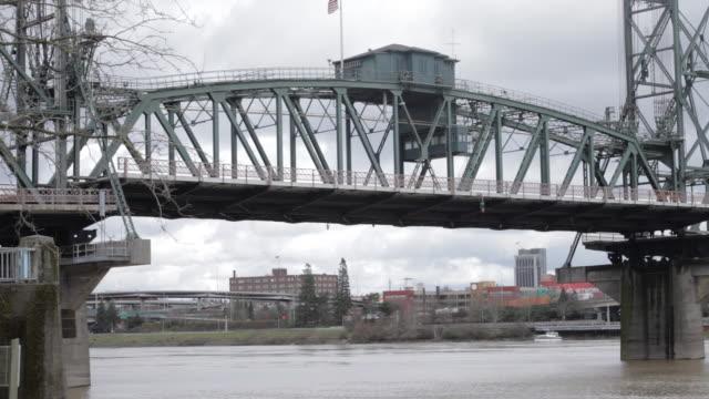 drawbridge rising, american flag on top - drawbridge stock videos and b-roll footage