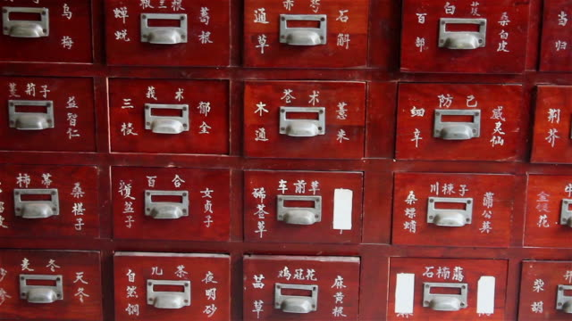 cu tu drawer of chinese herbs in eastern medicine hospital / xian, shaanxi, china - chinese herbal medicine stock videos and b-roll footage