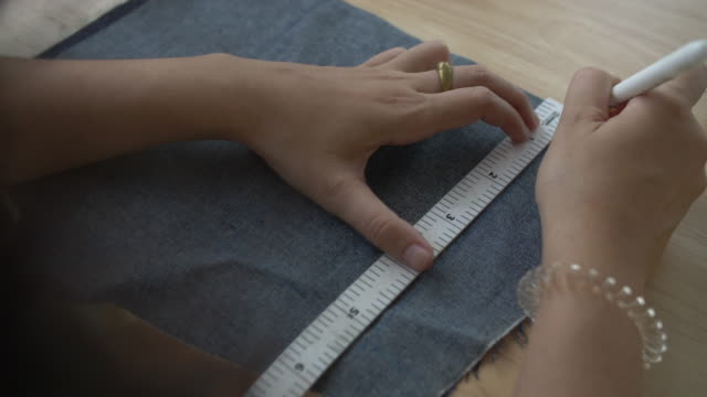 Drawing a draft with colored pencils on fabric