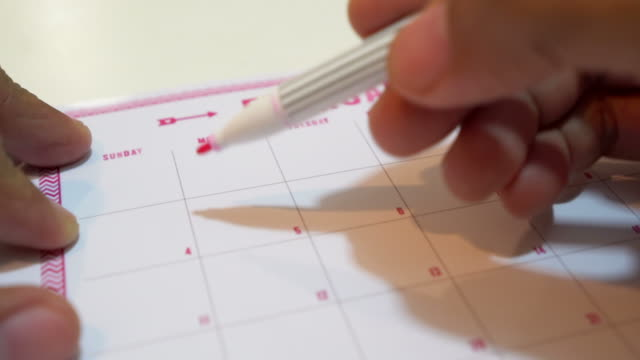 drawing a heart for valentines day on calendar - reminder stock videos and b-roll footage