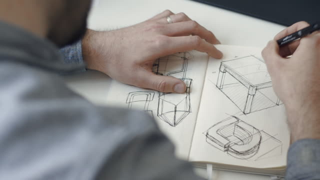 vídeos de stock, filmes e b-roll de drawing a table in a notebook - designer profissional