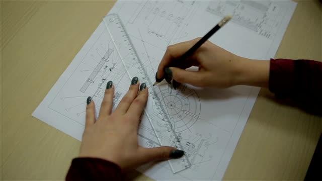 vídeos de stock, filmes e b-roll de desenho de um plano arquitectónico, close-up - architectural model