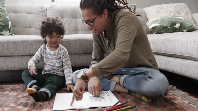 drawing can enhance your child's motor skills from a young age - home sweet home stock videos & royalty-free footage
