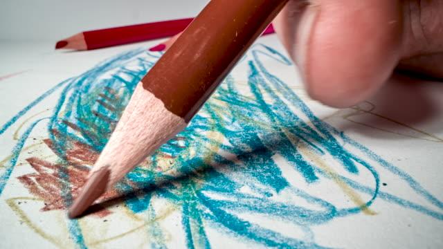 vídeos y material grabado en eventos de stock de dibujo en papel de dibujo blanco - lapiz
