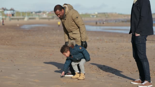 drawing pictures in the sand - whitley bay stock videos & royalty-free footage
