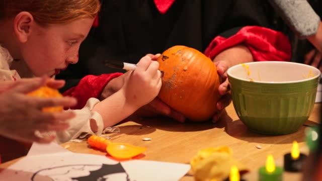 drawing pumpkin designs - intagliare video stock e b–roll