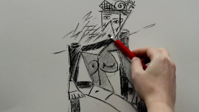 vídeos y material grabado en eventos de stock de drawing replica of pablo picasso's 'woman sitting in a chair' - pintor