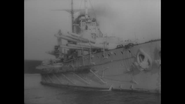 WWI dreadnought ship from the AustroHungarian Navy in Pola Austria / WS its dual three gun turrets swivel toward and past camera / LS ship crew...