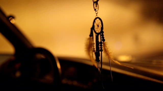 Dream catcher decoration in vintage car