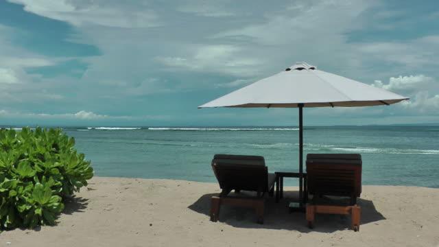 Dream vacation; blue sky,  ochre sand, white beach umbrella