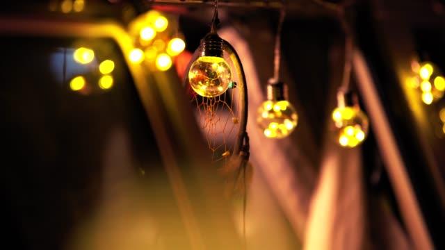 dreamcatcher and bulbs hanging on camping van - glowing doorway stock videos & royalty-free footage