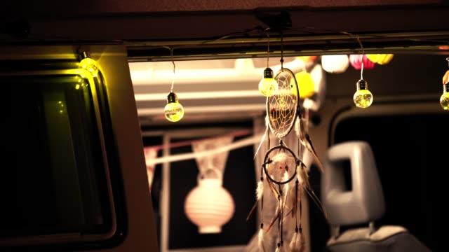dreamcatcher and light bulbs hanging on van - glowing doorway stock videos & royalty-free footage