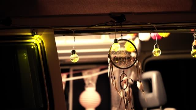 dreamcatcher hanging at van doorway - glowing doorway stock videos & royalty-free footage