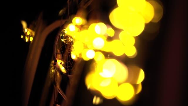 dreamcatcher hanging by bulbs on van at night - glowing doorway stock videos & royalty-free footage