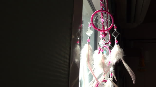 Dreamcatcher lucky charm hanging on the window