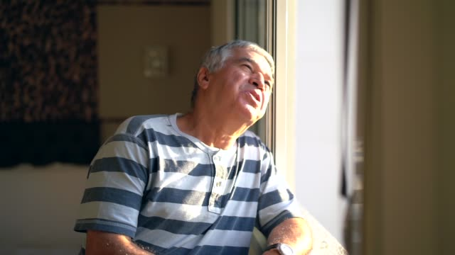 dreamer senior man looking through window - 60 64 years stock videos & royalty-free footage