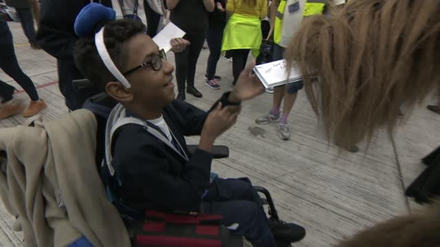 dreamflight charity takes ill and disabled children on trip to florida; england: london: vox pops children heathrow airport: gv children arriving at... - medical equipment stock videos & royalty-free footage