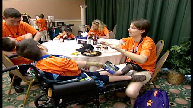 Dreamflight holiday for seriously ill children from London INT General view of children sitting at tables in dining room PAN Dreamflight volunteer...