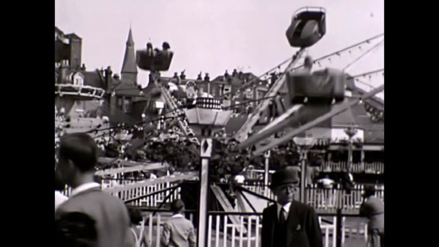 stockvideo's en b-roll-footage met dreamland fun park margate 1938 uk people walking through the park rollercoaster further shots of the park showing chocolate vending machines... - 1938