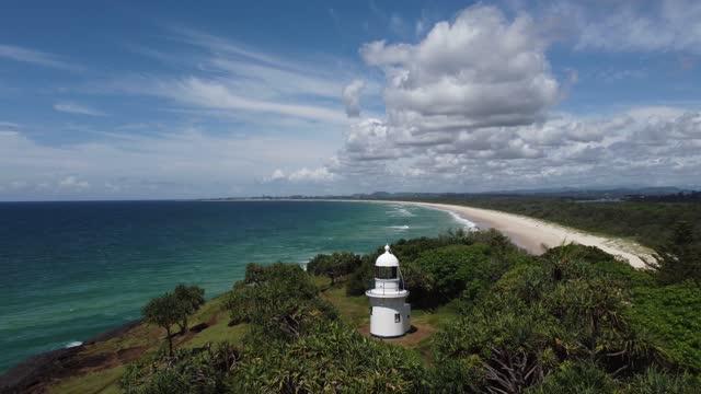 dreamtime beach and fingal headland and lighthouse, tweed coast australia - lighthouse stock videos & royalty-free footage
