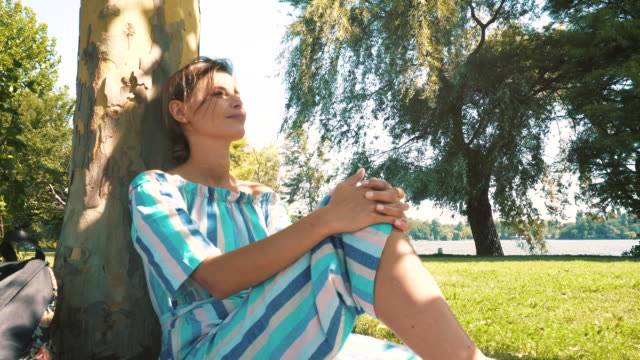 dreamy woman relaxing in park. - loneliness video stock e b–roll
