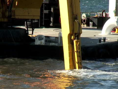 dredging sediment mud from under water, close up - bulldozer stock videos and b-roll footage