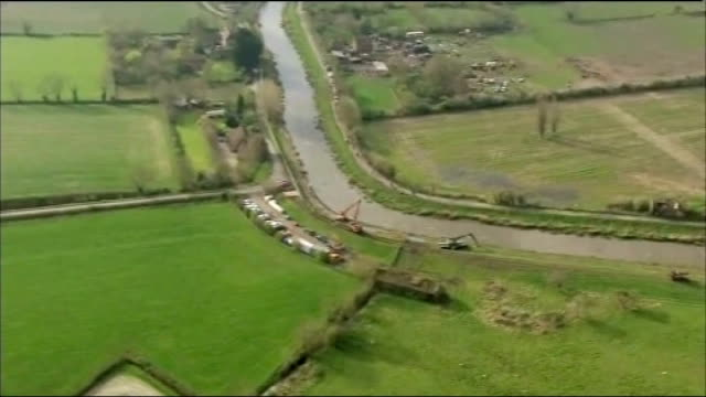 dredging starts on somerset levels air view / aerial stretch of the river parrett being dredged - somerset levels stock videos and b-roll footage