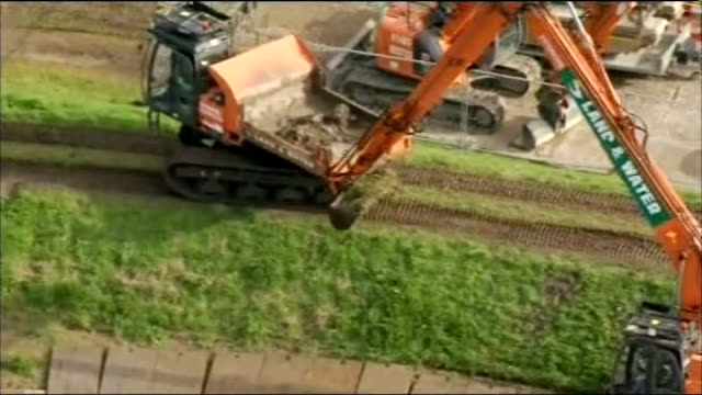 dredging starts on somerset levels england somerset mechanical digger being used to dredge the river parrett air view / aerial houses in village - somerset levels stock videos and b-roll footage