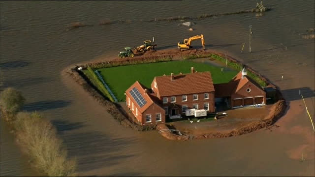 dredging starts on somerset levels file / recent air view aerial of house and surrounded by floodwater - somerset levels stock videos and b-roll footage