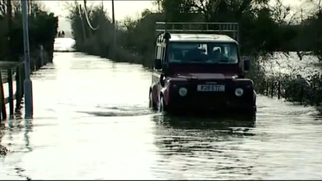 dredging starts on somerset levels file / recent landrover towards through flood water - somerset levels stock videos and b-roll footage
