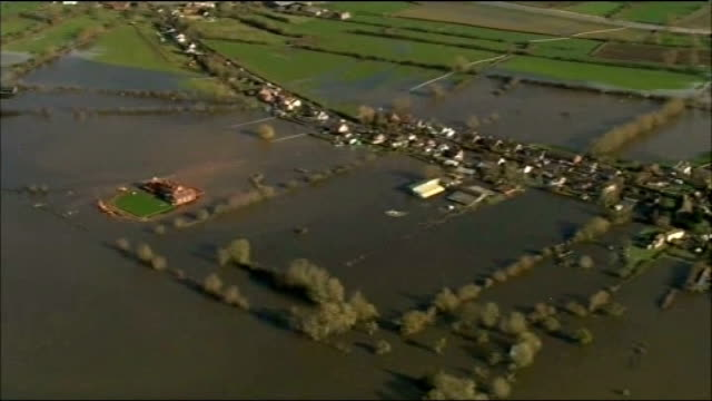 dredging starts on somerset levels r07021409 flooded village zoom in the home of notaro family who built a clay wall around his property to try to... - somerset levels stock videos and b-roll footage