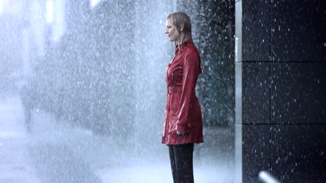 stockvideo's en b-roll-footage met drenched in the heavy rain (super slow motion) - kleding